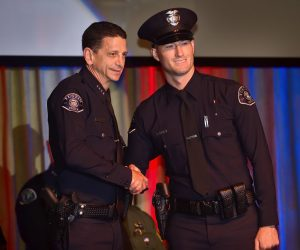 Tustin PD's newest officer, Robert Toth, right, is congratulated by Tustin Police Chief Stu Greenberg during the Orange County Sheriff's Regional Training Academy Class of 236 graduation ceremony. Photo by Steven Georges/Behind the Badge