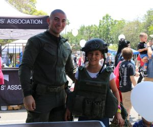 SWAT Officer and child smiling at 2019 TPD Open House