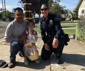 Homeless Liaison Officer - Homeless Liaison Officer De Leon giving a child an Easter basket