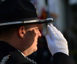 Honor Guard member saluting