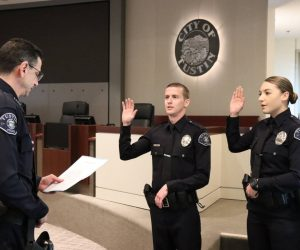 Chief Greenberg swearing in two new officers