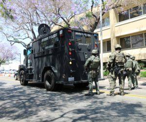 SWAT Team members standing next to SWAT vehicle