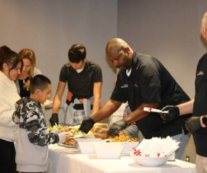 Members of Chief's Advisory Board serving dinner at Santa Cop event