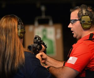 Alma Penalosa of Tustin gets ready to fire a xxx as Tustin PD Officer Andrew Gleason walks her through how to handle the rifle during a Tustin PD Citizen's Academy class at Evans Shooters World Firing Range in Orange. Photo by Steven Georges/Behind the Badge OC
