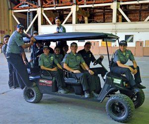 TPD Explorers riding on golf cart