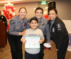 TPSSA Members picking shopping spree winner during 2019 Santa Cop event